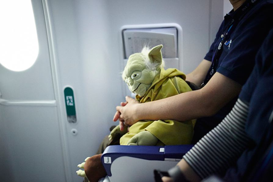 Yes - That's a Yoda puppet (in business class)
